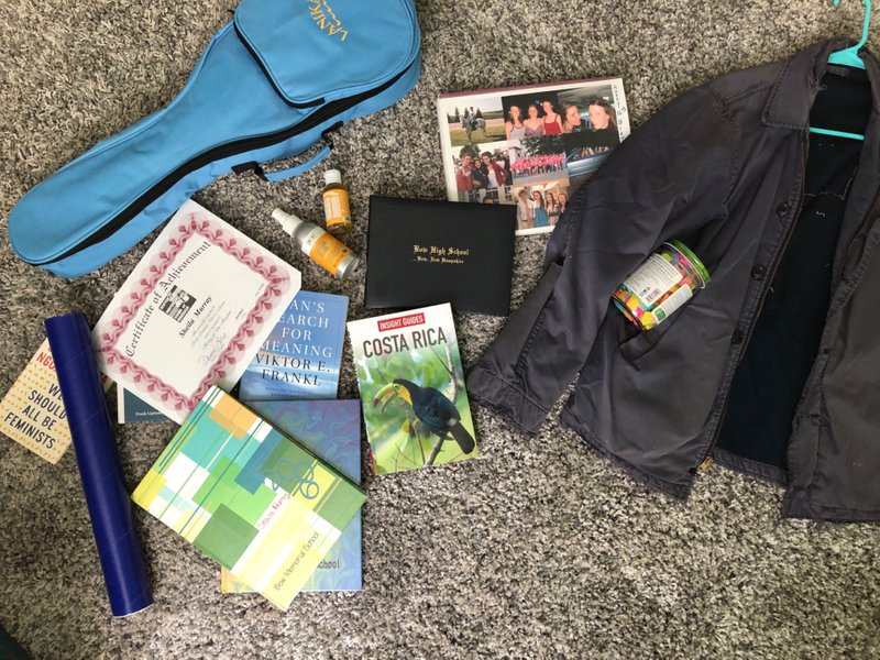 "A small pile of things I was sifting through including my ukulele, photo album from my 16th birthday, the ""grateful jar"" I kept for a year, and my Dad's Coast Guard jacket.  (No worries, Dad, I didn't give it away!)"