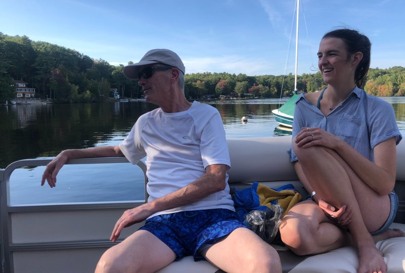 My dad and me, enjoying a blue-bird day on a New Hampshire lake with my mom's brothers.