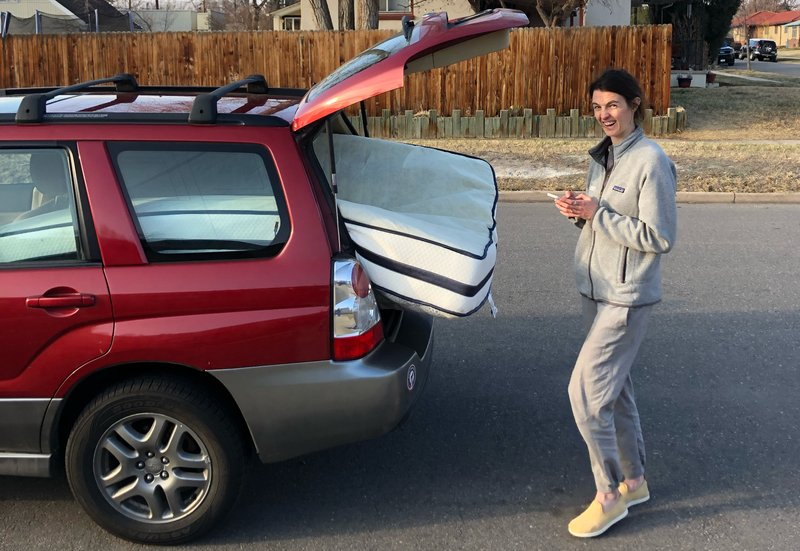 Packin' a queen mattress into the Subaru. No truck needed when you have a hatchback & hope.
